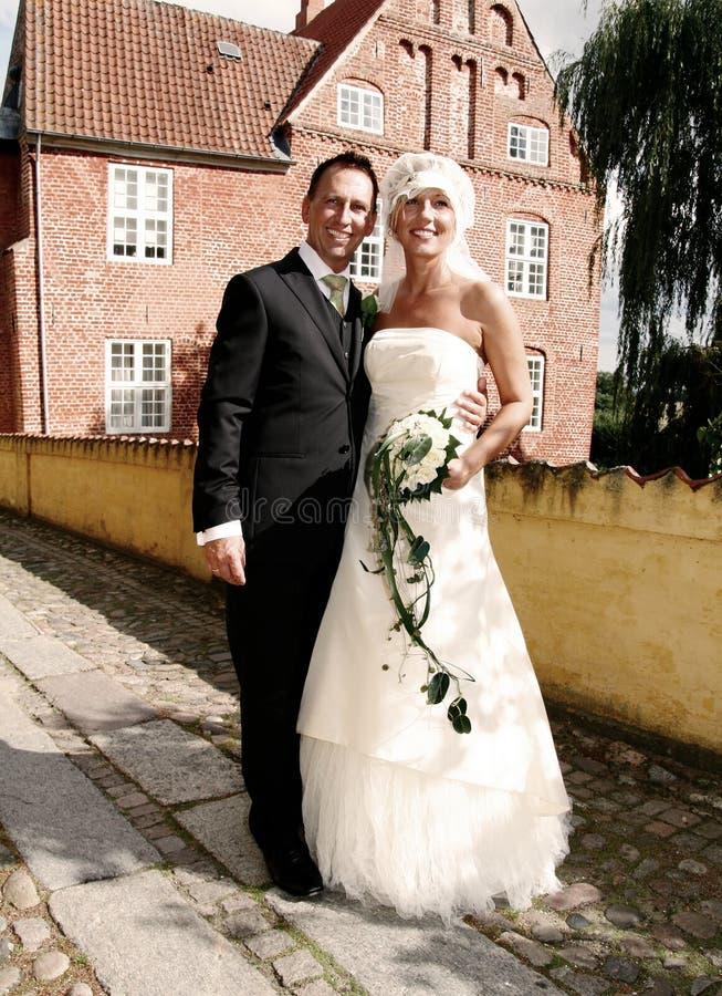 Wedding couple manor house stock photography