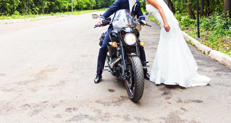 Wedding couple on motorcycle royalty free stock photos
