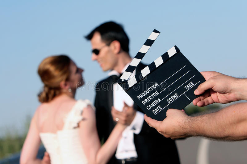 Wedding couple. Movie clapper board stock photography