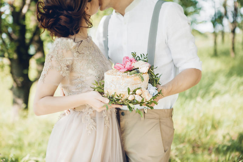 Wedding couple on nature. the bride and groom with cake at wedding. royalty free stock photos