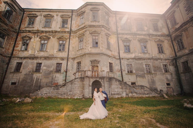 Wedding couple near the old architecture royalty free stock photo