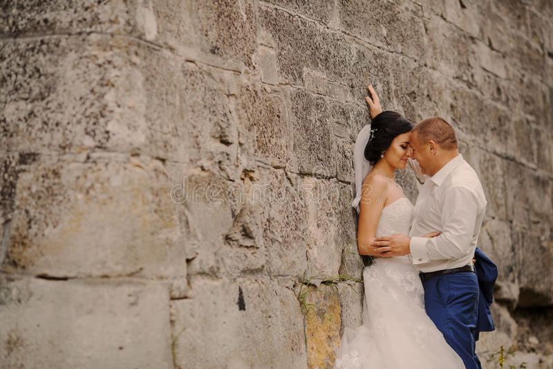 Wedding couple near the old architecture royalty free stock image