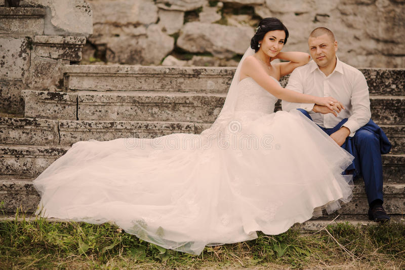 Wedding couple near the old architecture stock images
