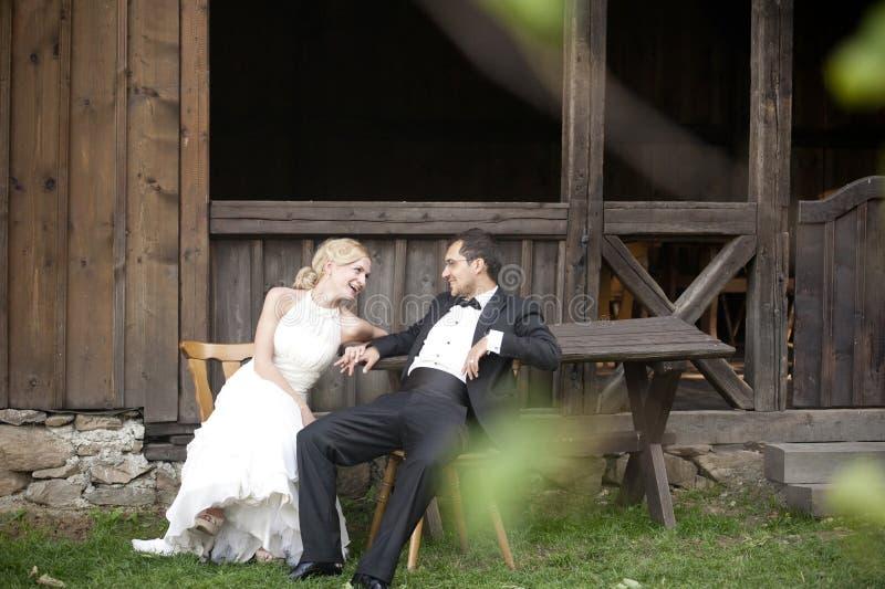 Wedding couple. Near an old house stock photo