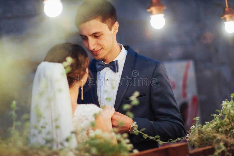 wedding couple at night lighting. Cafe along with decoration lig royalty free stock image