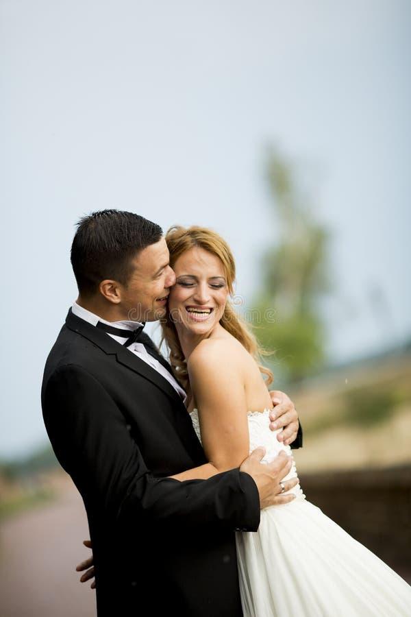 Wedding couple outdoor. On the wedding day stock photos