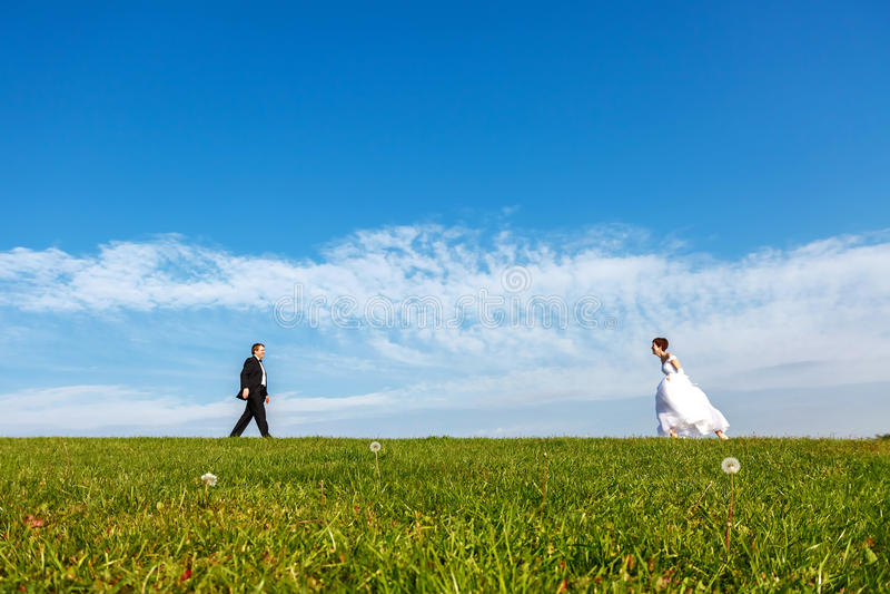 Wedding couple outdoors on blue sky background. royalty free stock photo