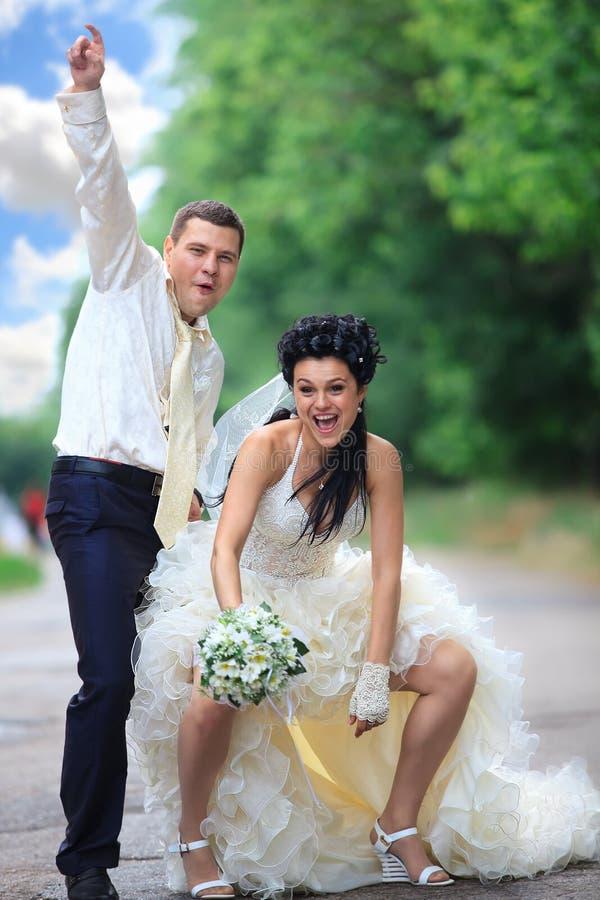 Wedding couple at a park stock photo