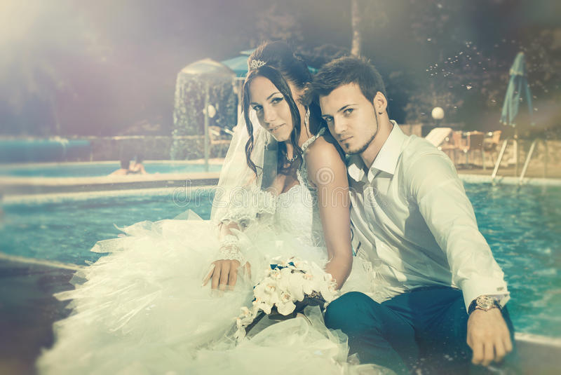 Download Wedding couple at pool stock image. Image of relationship - 26579917