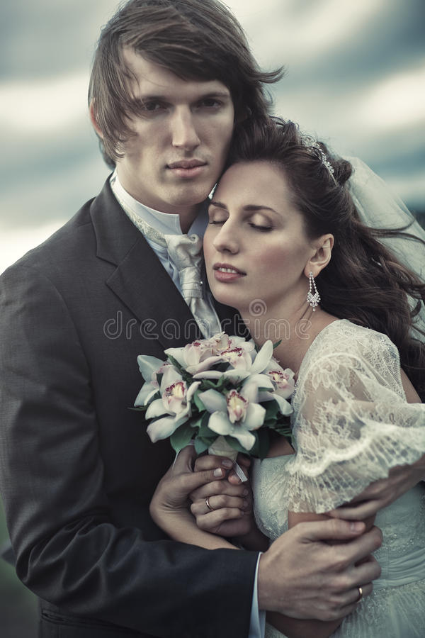Wedding couple portrait. Young wedding couple tender portrait stock image