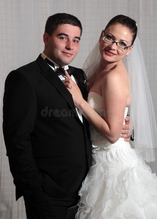 Wedding couple portrait. Young wedding couple studio portrait royalty free stock photography