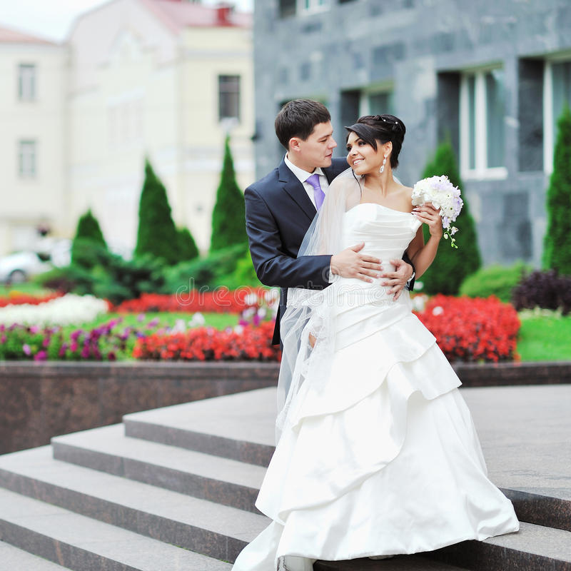 Wedding couple posing in an old town. Outdoor stock images