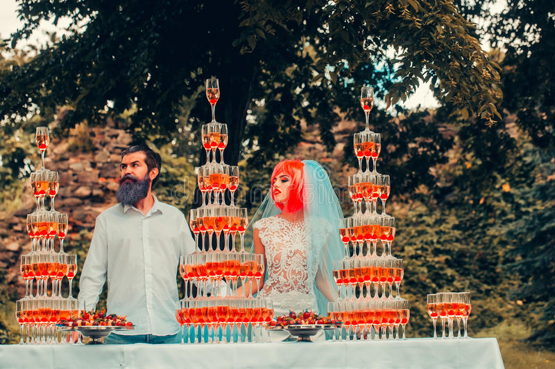 Wedding couple with pyramids of wine glasses outdoor stock photos