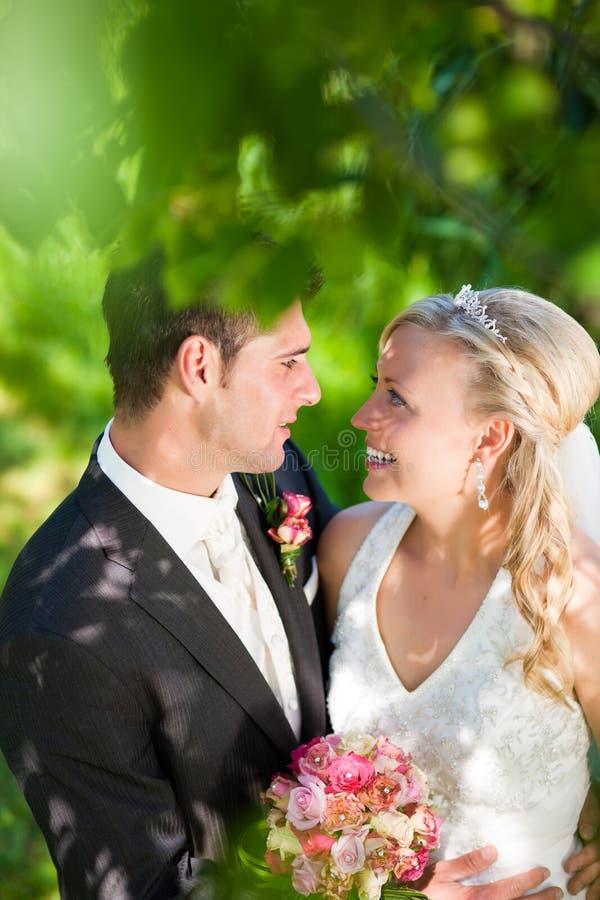 Wedding couple in romantic setting stock photo
