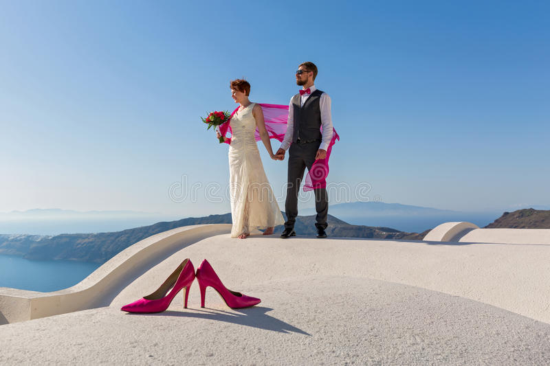 Wedding couple on the roof stock photography