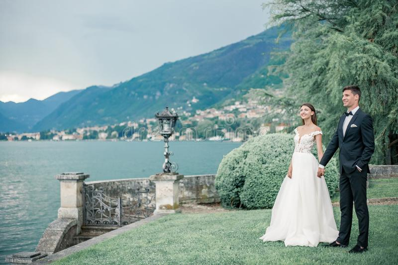 Wedding couple against the background of the lake and mountains royalty free stock photo