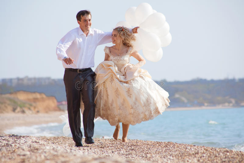 Download Wedding Couple Running On Beach Stock Image - Image of beach, embracing: 12921029