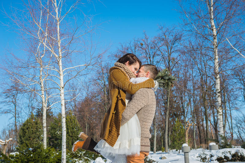 Wedding Couple In A Showy Wither Day, Holding Each Other, Having Fun ...