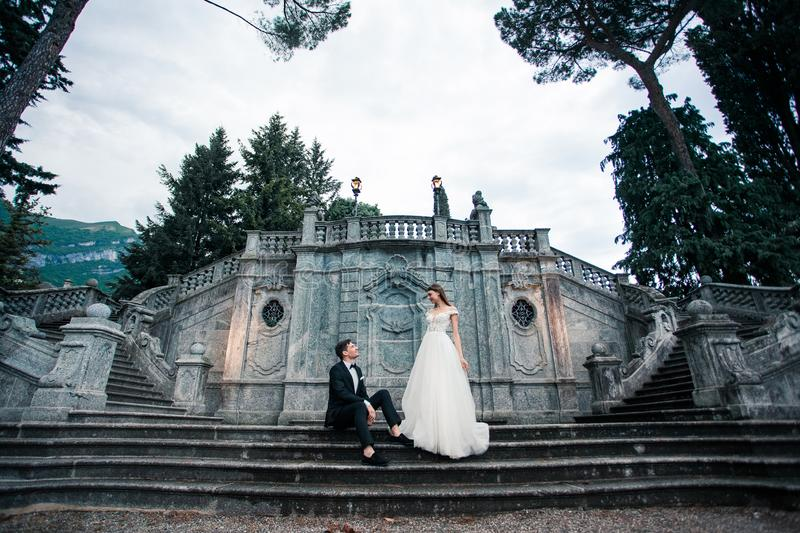 Wedding couple on the stairs in the park royalty free stock photography