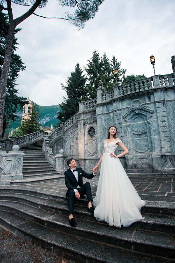 wedding couple on the stairs in the park stock photography