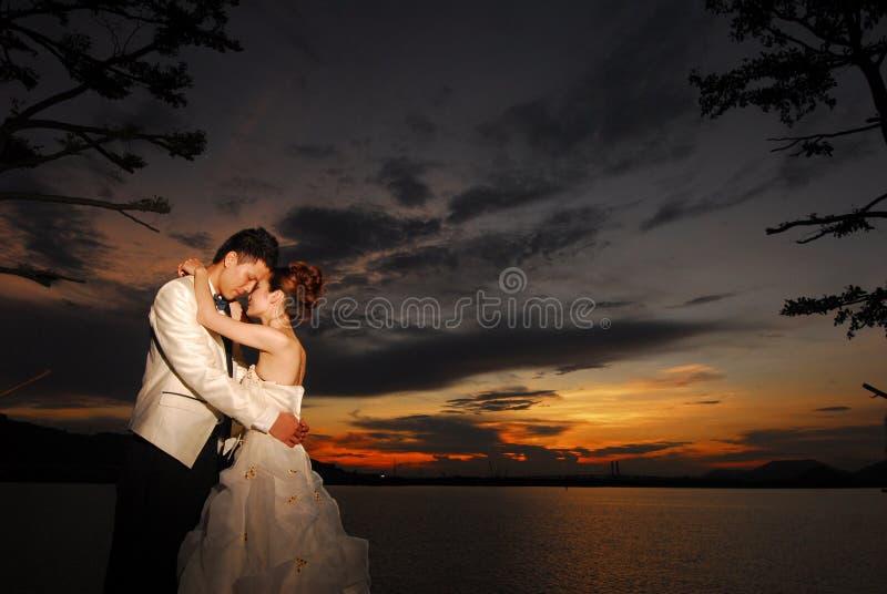 Wedding couple sunset. Asian Wedding couple during sunset