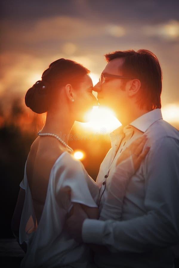 Wedding couple. On sunset royalty free stock photography