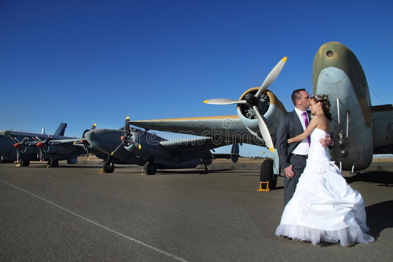 Download Wedding Couple With Vintage Airplanes Stock Photo - Image of bride, romantic: 48880766