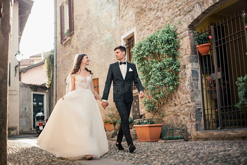 Wedding couple walking down a street royalty free stock images