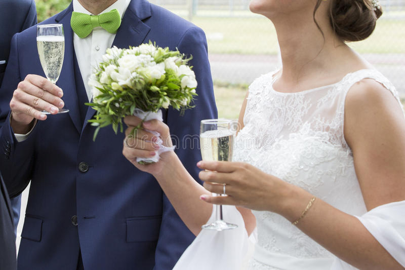 Wedding couple white bridal dress and bleue suit with champagne glass royalty free stock photos