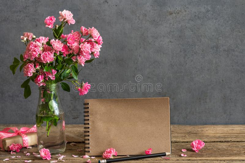 Wedding craft paper card with bouquet of pink rose flowers in vase. mock up. holiday or wedding background royalty free stock images