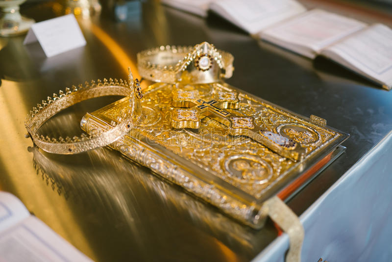 Wedding crowns and bible. Orthodox wedding crowns and bible prepared for ceremony royalty free stock photo
