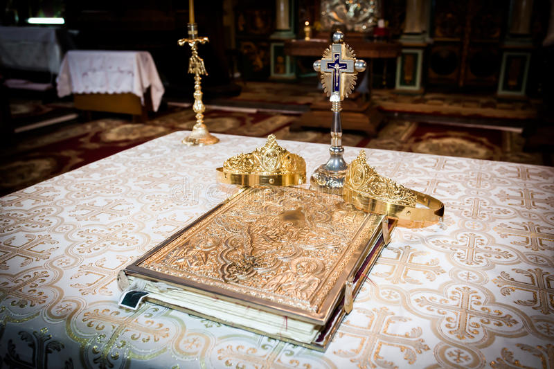 Wedding crowns and bible. Prepared for ceremony royalty free stock images
