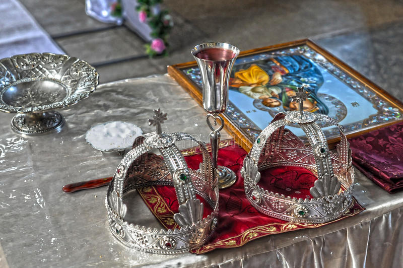 Wedding crowns. In church on table stock images