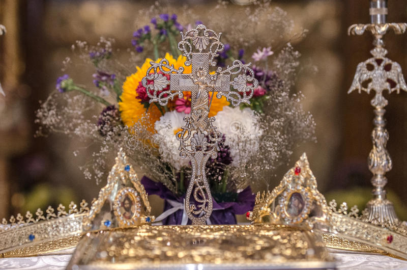 Wedding crowns. Wedding golden crowns and silver cross royalty free stock image