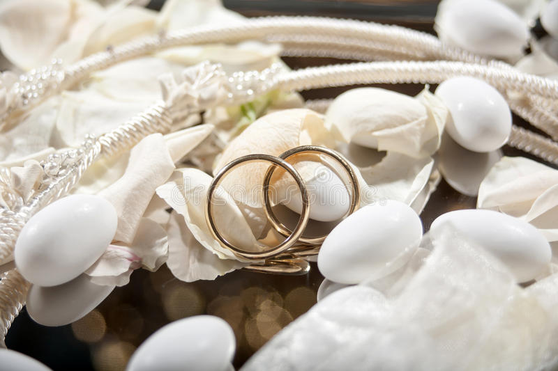 Wedding crowns and rings. Closeup of wedding crowns and rings decorated stock images