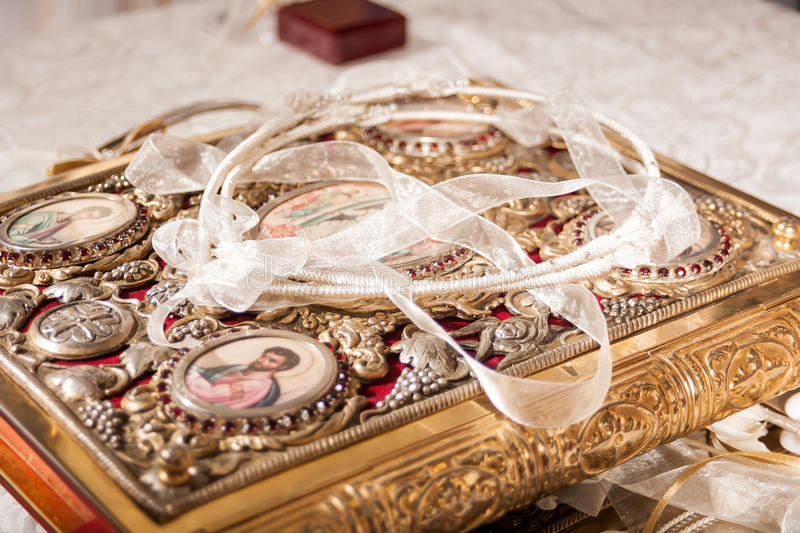 Wedding crowns and rings. Closeup of wedding crowns decorated on a gospel stock photography