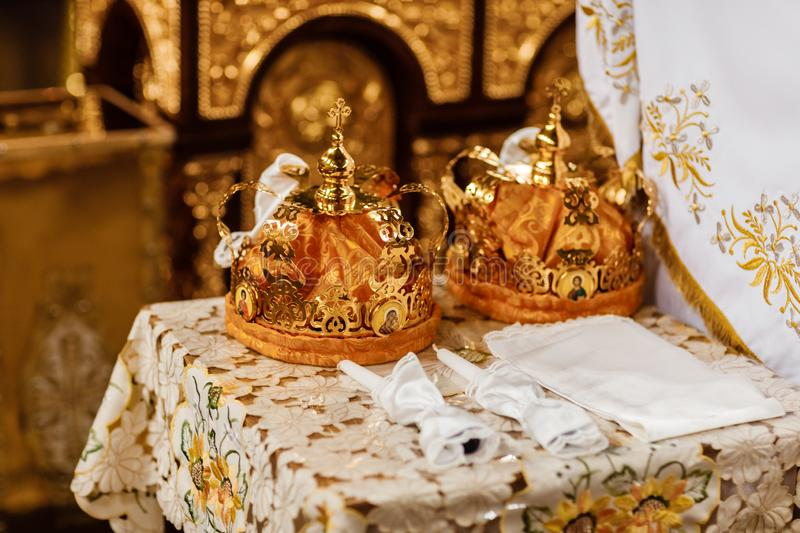 Wedding crowns. Wedding crown in church ready for marriage ceremony. close up. Divine Liturgy. Wedding crowns. Wedding crown in church ready for marriage royalty free stock image