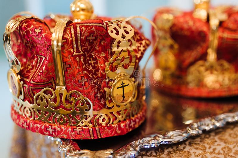 Wedding crowns. In church ready for marriage ceremony. close up. crown the glans in the church on table stock image