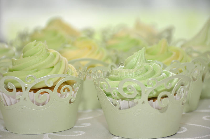 Wedding cup cakes lime and lemon royalty free stock photography