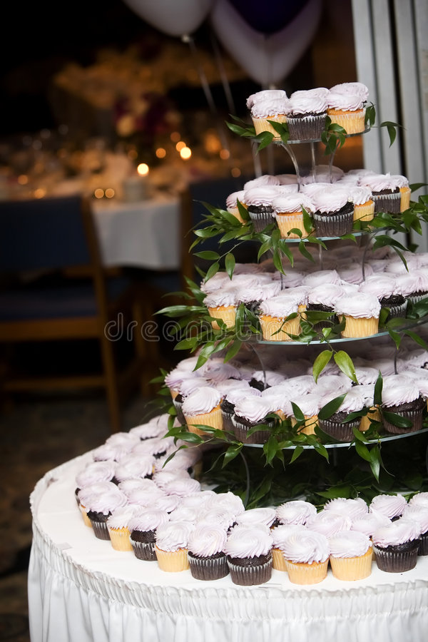 Wedding cupcakes. Many weddings are skipping the wedding cake and serving cupcakes instead stock images