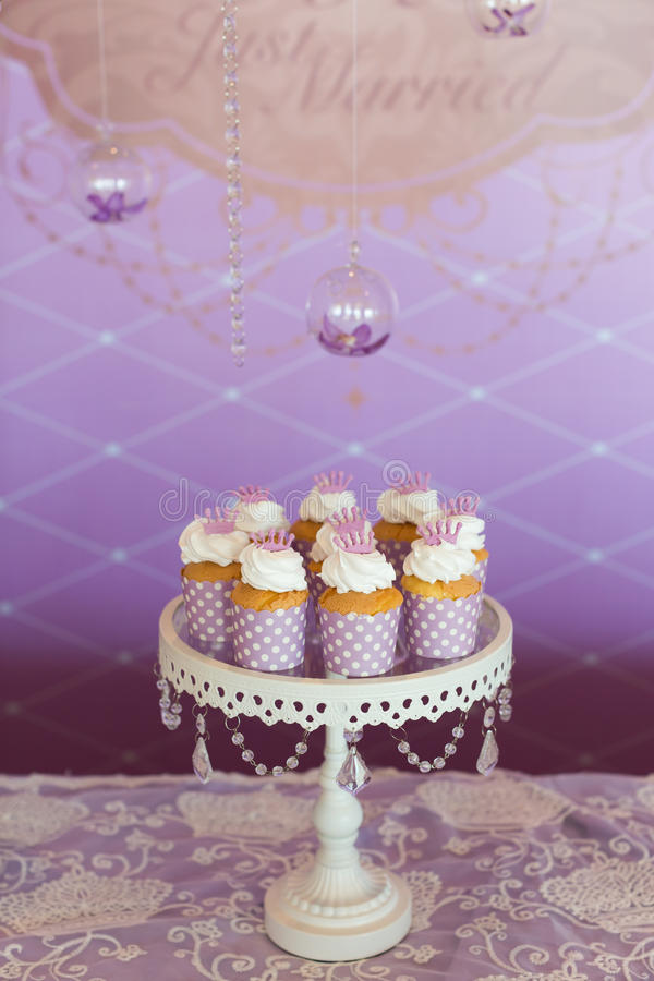 Wedding cupcakes. Wedding cakes at an indoor wedding party stock images