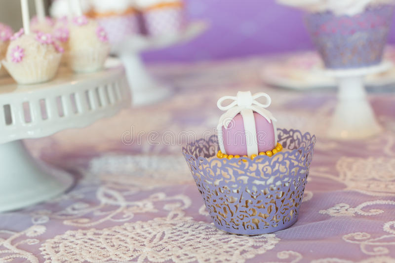 Wedding cupcakes. Wedding cakes at an indoor wedding party royalty free stock photography