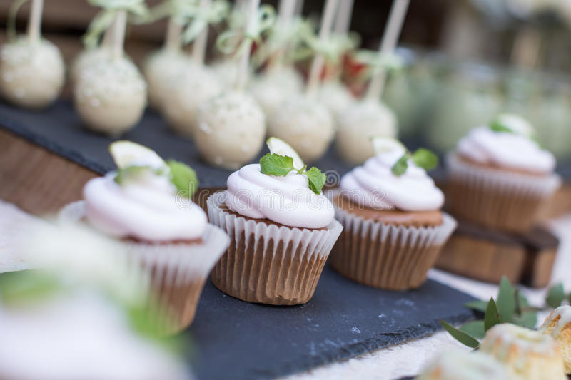 Wedding cupcakes. Wedding cakes at an outdoor wedding party royalty free stock images