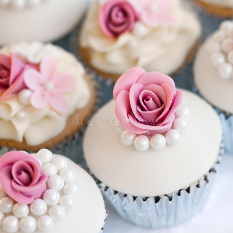 Wedding cupcakes. In silver foil wrappers stock photography
