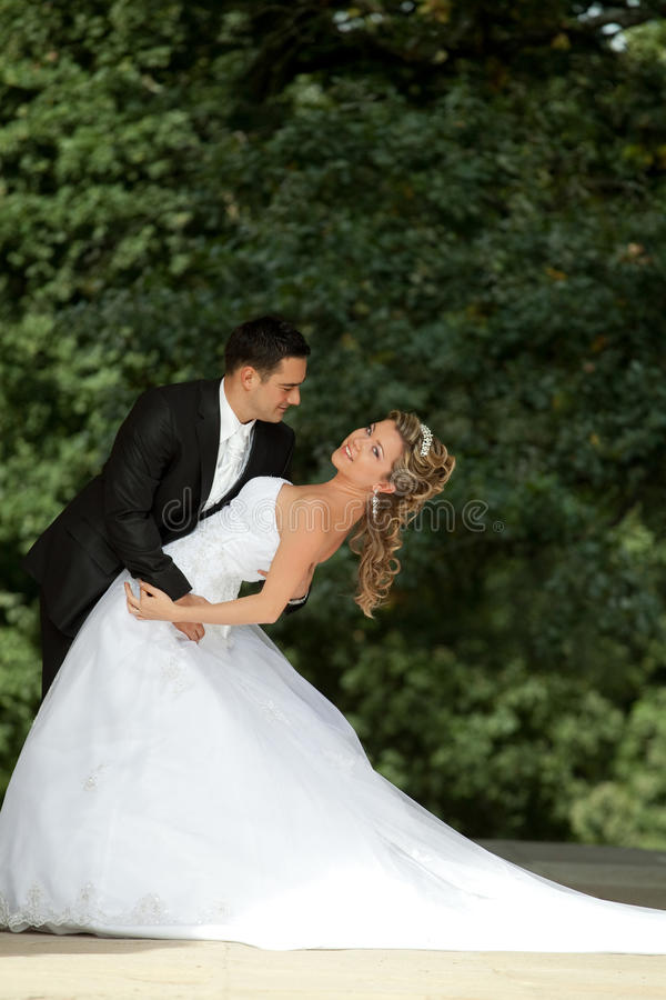 Wedding dance. Outdoor shot happy couple royalty free stock photo