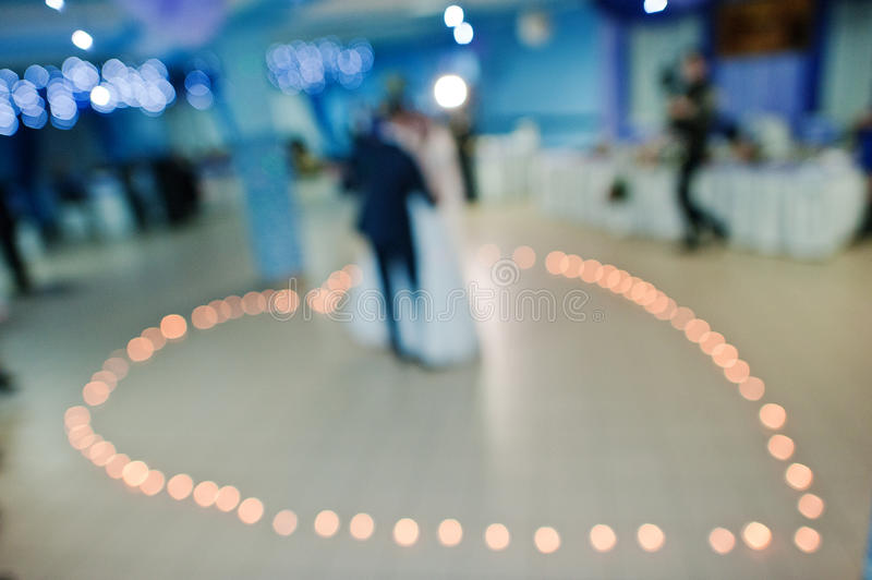 Wedding dance on candle of heart. Blured effect royalty free stock image