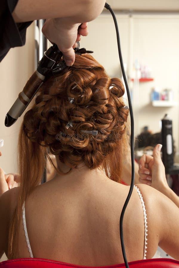 Wedding day. Bride having hairdo on her wedding day stock photo