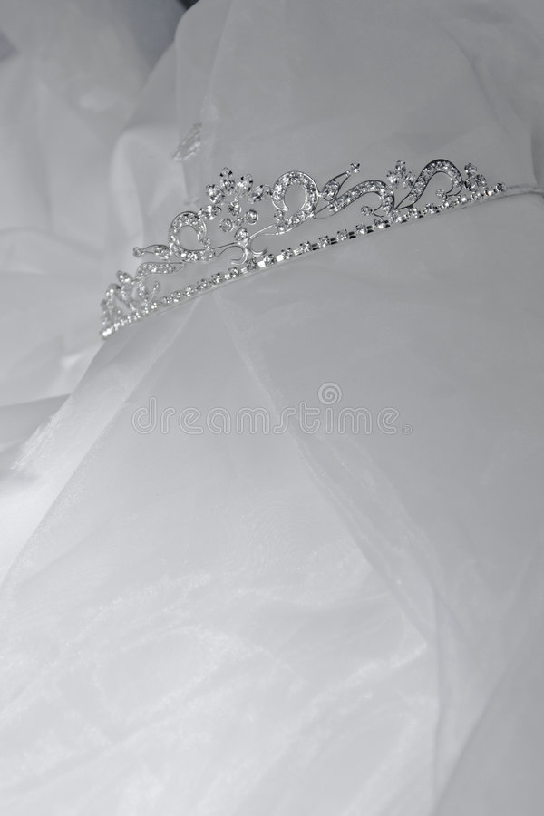 Wedding day. Wedding diamond tiara over white tulle stock image