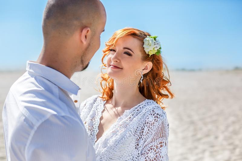 Wedding day. Portrait of beautiful bride with groom in the desert royalty free stock images