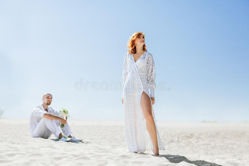 Wedding day. Portrait of beautiful bride with groom in the desert stock image